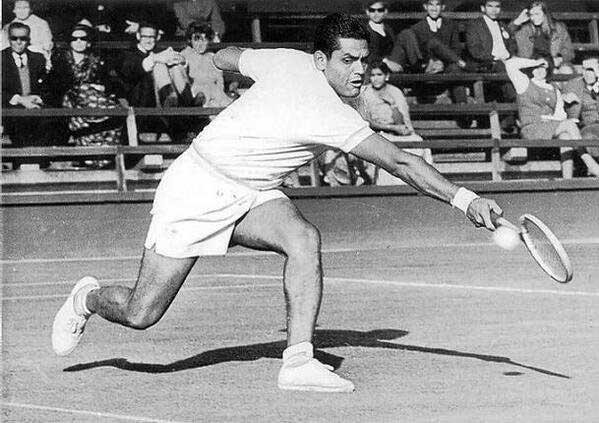 Ramanathan Krishnan plays a backhand shot during a tennis match