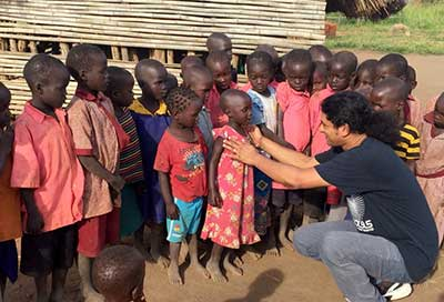 Shaison P. Ouseph with African children