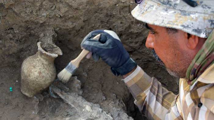 Male archaeologist at work