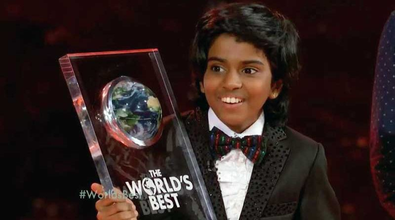 Lydian Nadhaswaram holding up The World's Best trophy