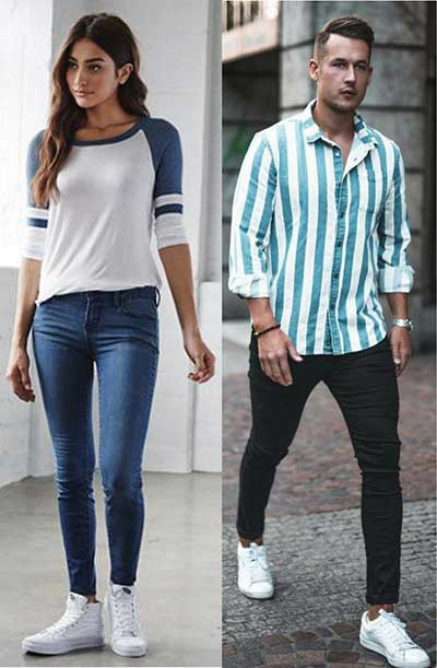 Young man and woman wearing skinny fit jeans