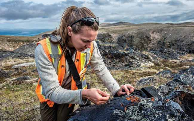 Female geologist examining rock samples