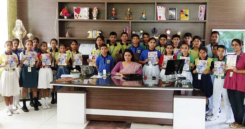 Dr Harleen Kaur, Founder-Principal of Mount Carmel International School, Naraiangarh, with students holding up copies of The Teenager Today