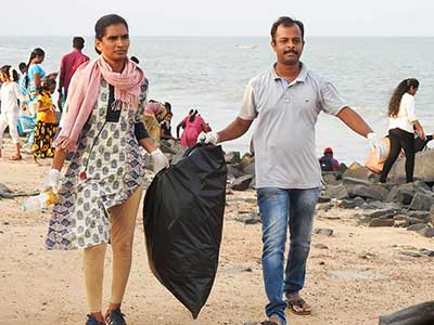Kannan, founder of KPC, participates in a clean up