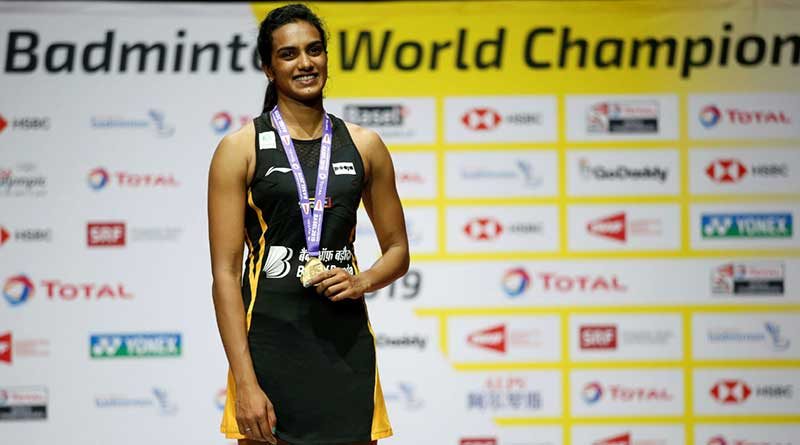 Sindhu with her gold medal at the Badminton World Championships