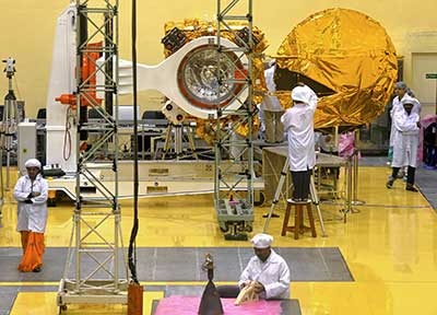 Scientists and engineers work on a Mars orbiter vehicle at ISRO's satellite center in Bangalore