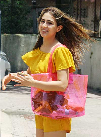Sara Ali Khan carrying a pink see-through tote bag