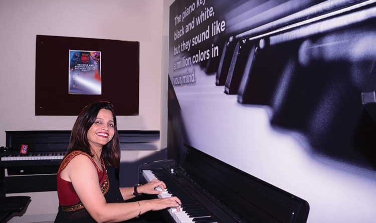 Dharini Upadhyay, co-founder & co-CEO of Furtados School of Music at a piano