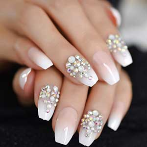 Ballerina or coffin-shaped nails with embellishments