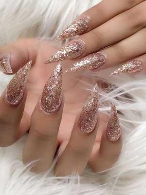 Stilletto nail shape with glitter nail art