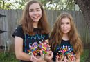 Isabelle and Katherine Adams with their origami products