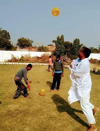 Shreenarayan playing with students at Rajkiya Mamta Vidyalaya Kodihar