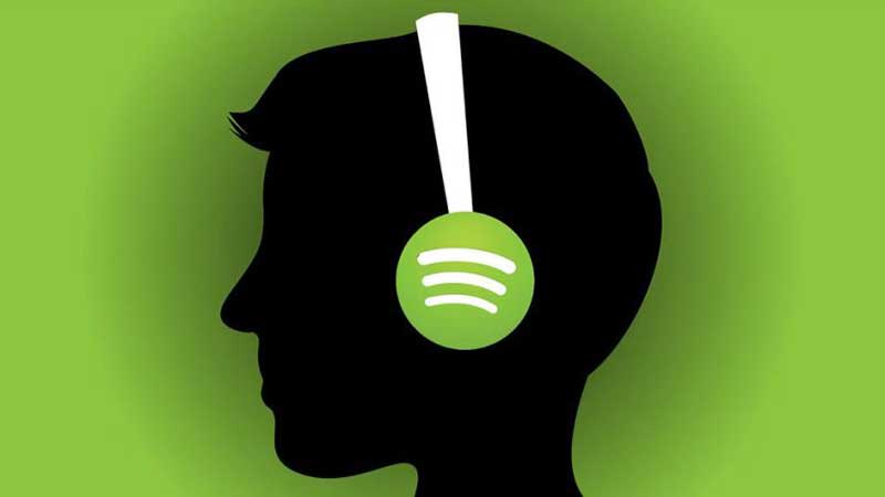 Silhouette of a man's head wearing headphones with Spotify logo