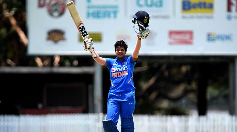 Shafali Verma raising her helmet and bat