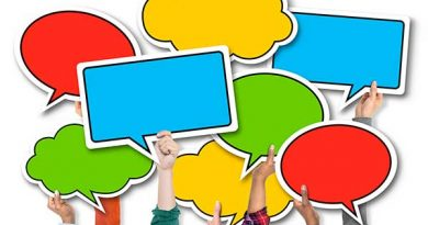Hands holding up colourful speech bubbles