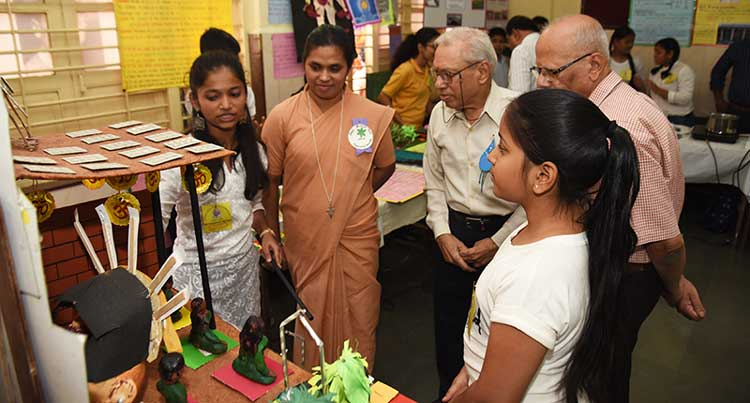 Senior scientist,  Dr A. M. Bhagwat, views the exhibition