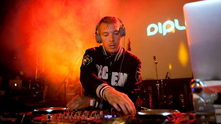 Diplo DJing live at a music festival