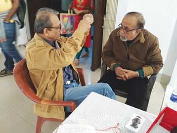 Manoj engaged in an intense discussion with noted artist Aditya Basak