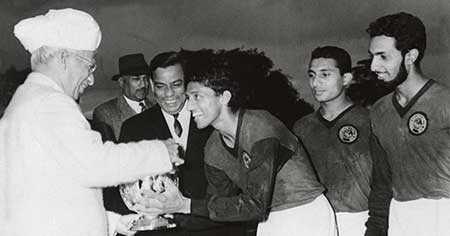 Chuni Goswami  receiving a trophy from late President of India  Dr Radhakrishnan (1963)