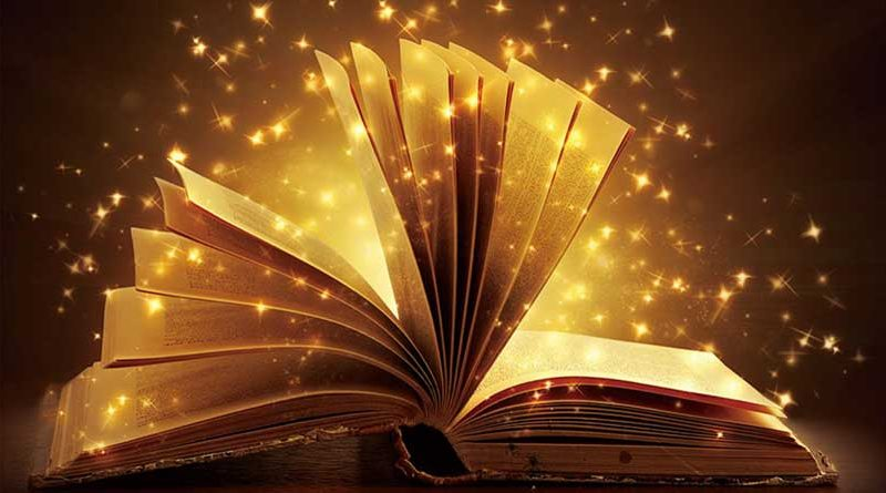 Open book with golden sparkles around it