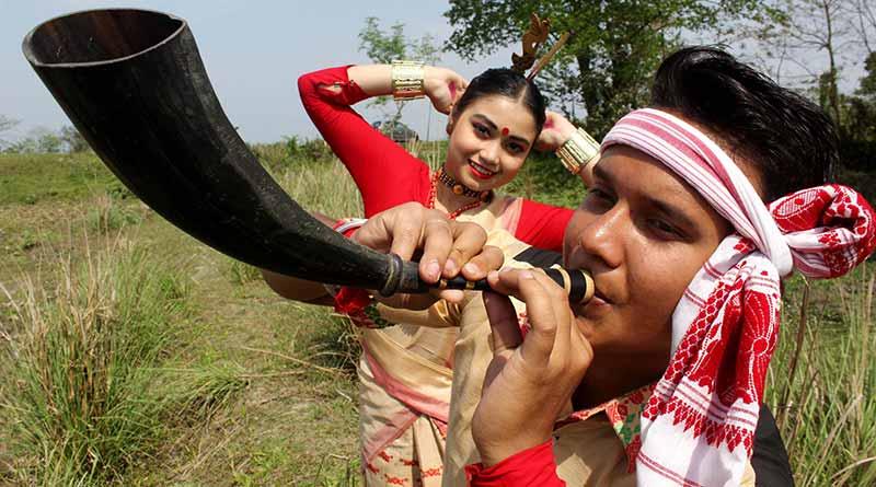 Bihu youth playing a musical instrument