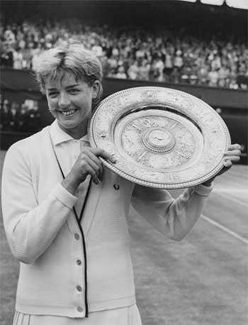 Margaret Court holding up the Wimbledon trophy in 1965