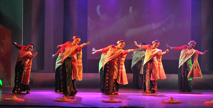 Women performing Bihu Dance on stage