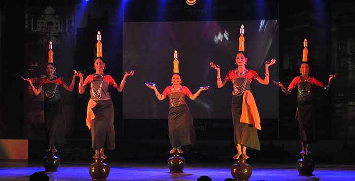 Female dancers performing Hojagiri Dance on stage