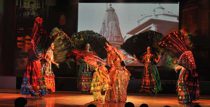Women performing the Mayur dance on stage