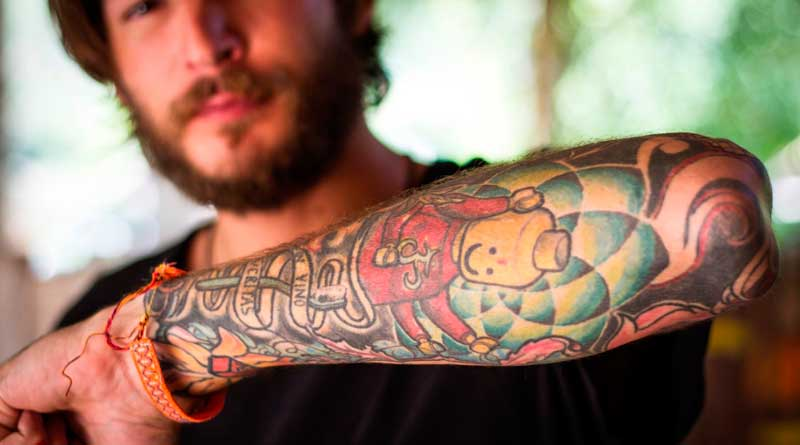 Man with forearm tattoo