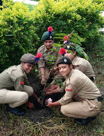 Cadets from the National Cadet Corps planting saplings