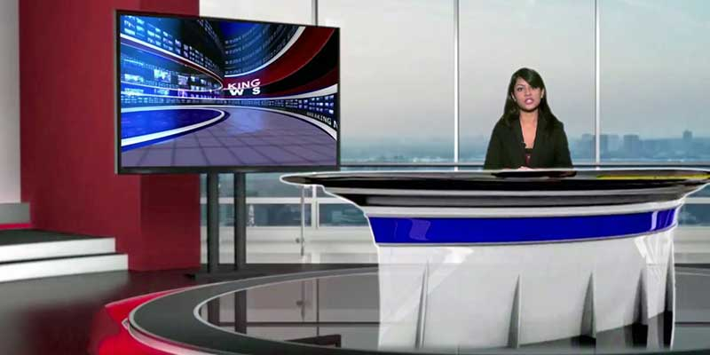 Female news anchor reading the news