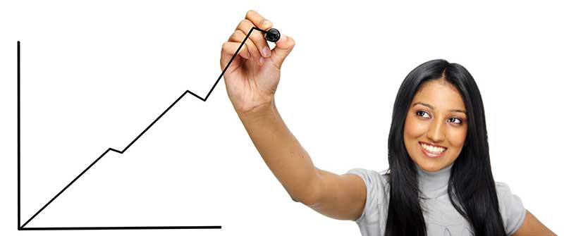 Young woman drawing a upward moving graph