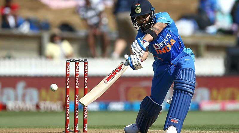 Virat Kohli batting and hitting a four