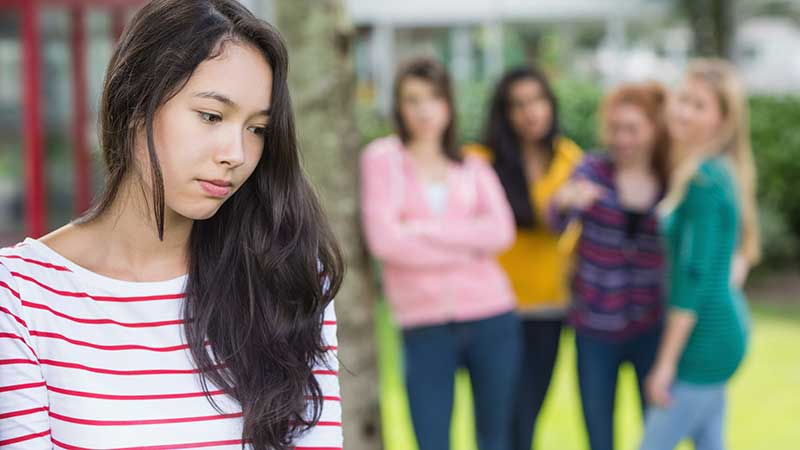 Female student being pressure or bullied by a group of students