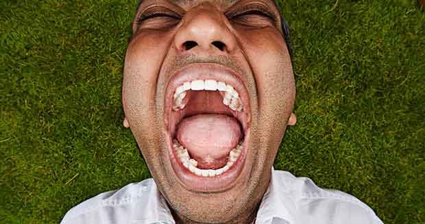 Vijay Kumar displaying his teeth