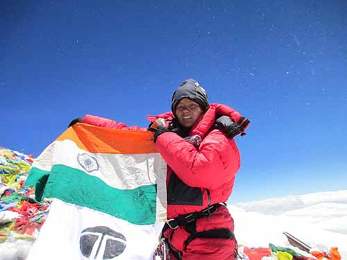 Arunimha Sinha with the Indian flag at the top of Mount Everest