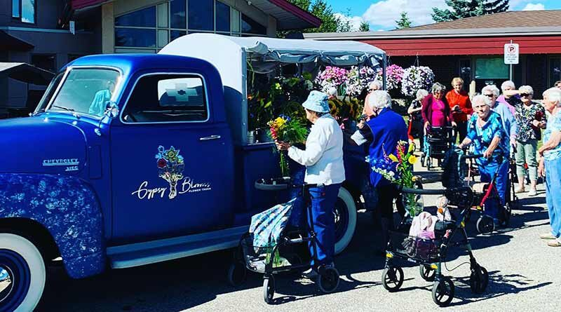 A truckload of flowers delivered to an old people's home