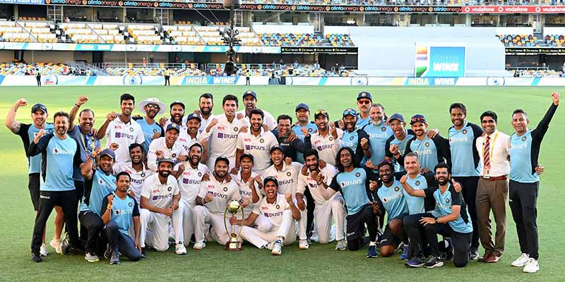 Team India poses with the winning trophy after defeating Australia by three wickets on the final day of the fourth cricket Test match at the Gabba, Brisbane, Australia on January 19, 2021