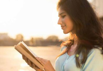 Young woman reading a book and smiling