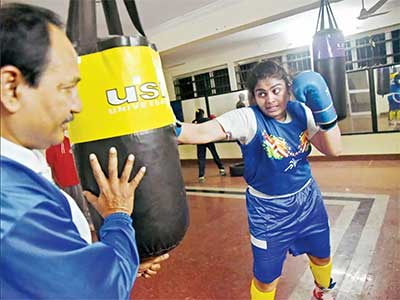 Alfiya practising and sparring with coach Ganesh Purohit