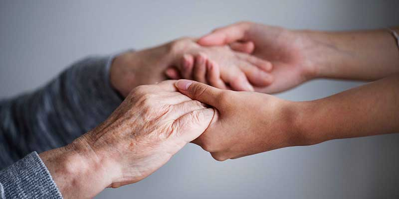 Old hands being held by younger ones