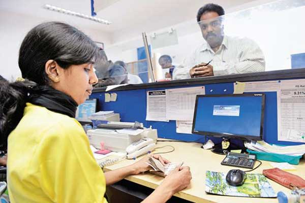 Officer in a bank attending to a customer