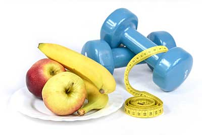 Healthy food, fruit, exercise equipment