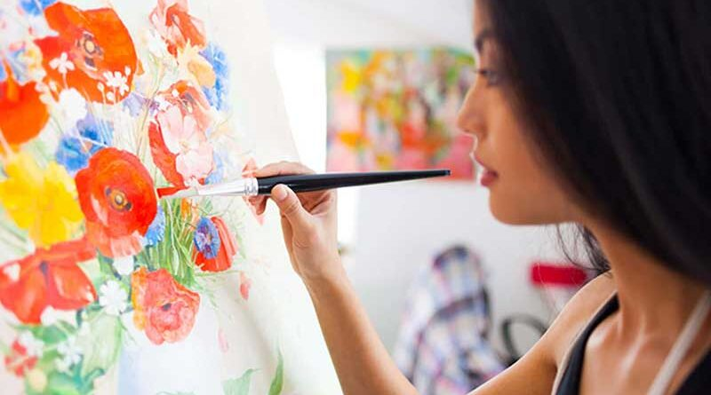 Female artist painting on a canvas