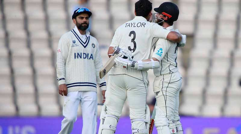 Virat Kohli watches as New Zealand captain Kane Williamson (right), and Ross Taylor celebrate their win
