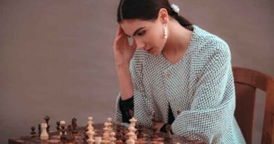 Woman thinking while playing chess