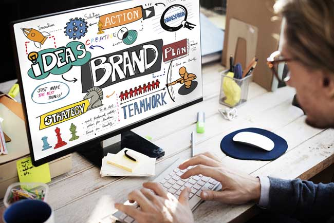 Man working on branding and marketing of a product