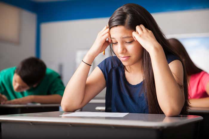 Girl looking worried at examination