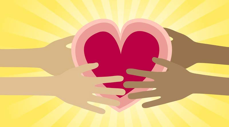 Compassionate hands holding heart